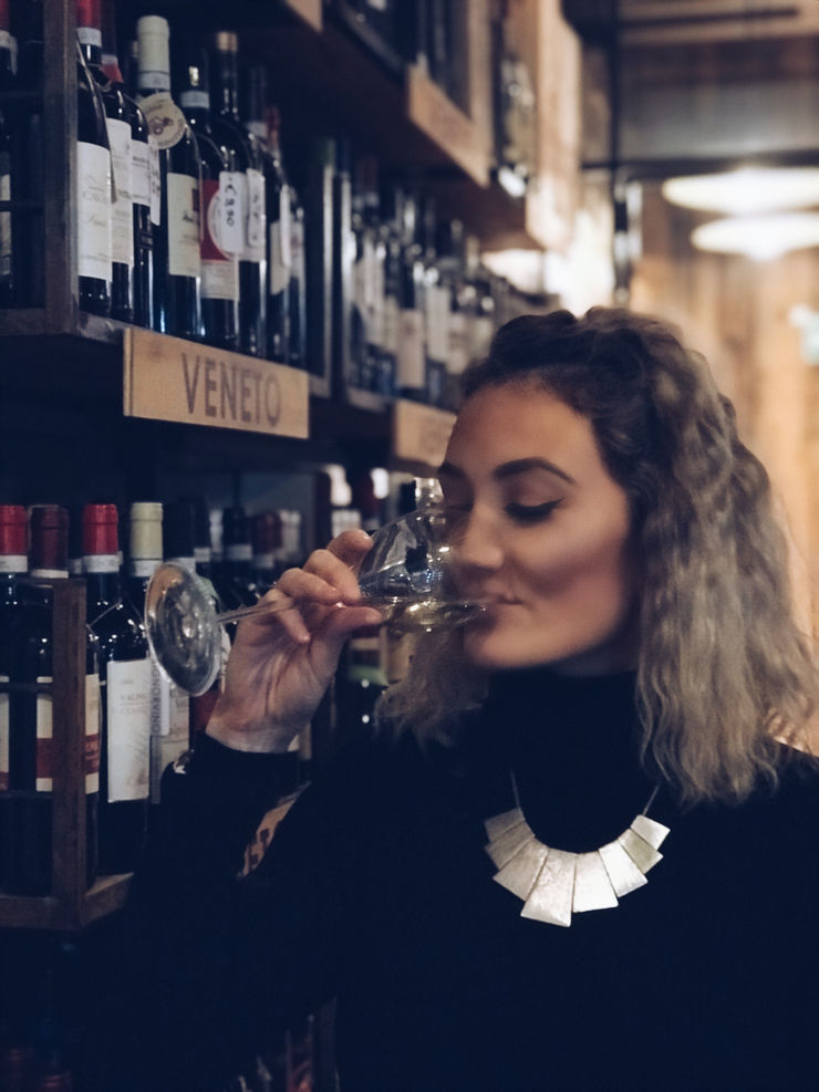 Girl Going Global enjoys wine at Signor Vino wine shop, Verona
